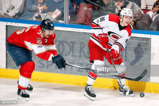 Teuvo Teravainen of the Carolina Hurricanes crosses sticks with Jussi Jokinen at the BBT Center on February 28 2017 in Sunrise Florida