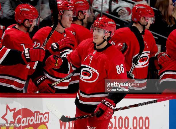 Teuvo Teravainen of the Carolina Hurricanes is congratulated by teammates after scoring a goal during an NHL game against the New York Islanders on...