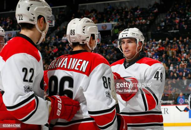 Teuvo Teravainen of the Carolina Hurricanes is congratulated by his teammates Brett Pesce and Victor Rask after scoring a second period goal against...