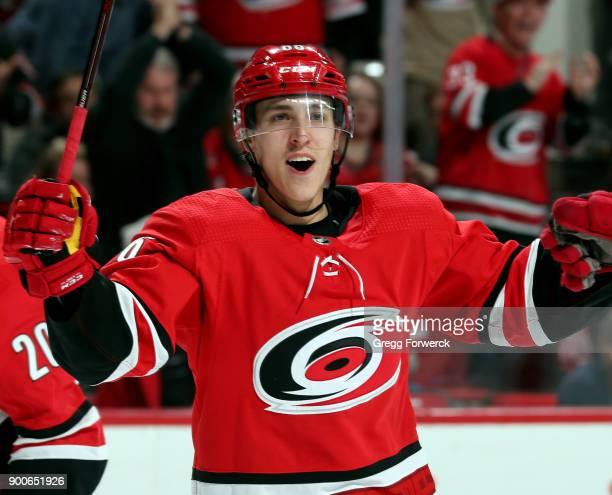 Teuvo Teravainen of the Carolina Hurricanes is credited with a goal tipped into the goal by Brooks Orpik of the Washington Capitals during an NHL...