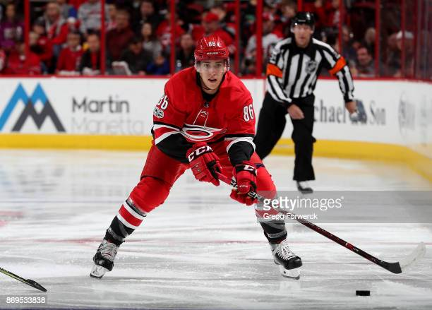 Teuvo Teravainen of the Carolina Hurricanes moves a puck on the ice against the Anaheim Ducks during an NHL game on October 29 2017 at PNC Arena in...