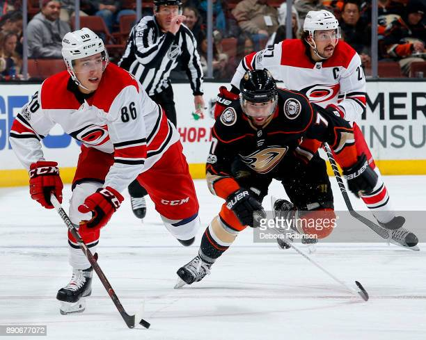 Teuvo Teravainen of the Carolina Hurricanes skates with the puck with pressure from Andrew Cogliano of the Anaheim Ducks during the game on December...