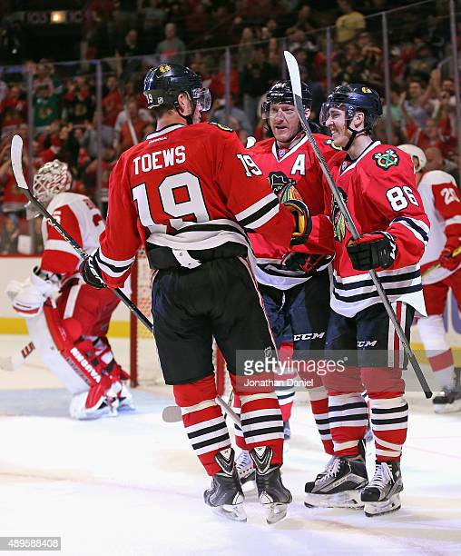 Teuvo Teravainen of the Chicago Blackhawks is congratulated by teammates Jonathan Toews and Marian Hossa after scoring a 2nd period goal against the...