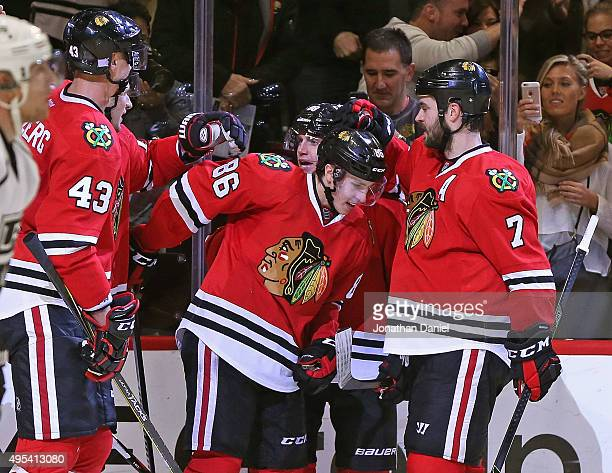 Teuvo Teravainen of the Chicago Blackhawks is congratulated by teammates Viktor Svedberg Artem Anisimov Patrick Kane and Brent Seabrook after scoring...