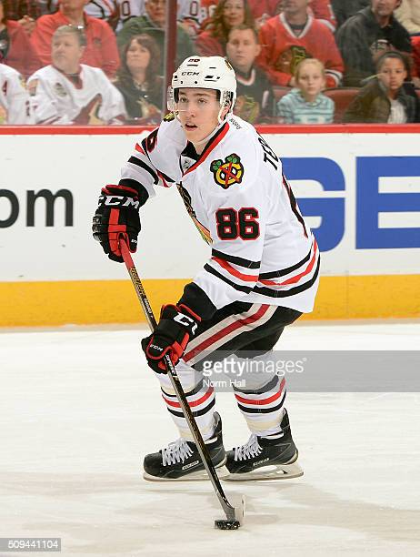 Teuvo Teravainen of the Chicago Blackhawks skates the puck up ice against the Arizona Coyotes at Gila River Arena on February 4 2016 in Glendale...