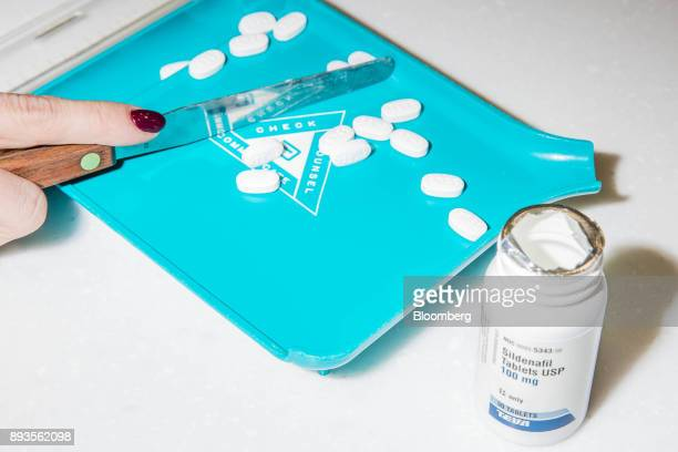 Teva Pharmaceutical Industires Ltd Sildenafil tablets the generic name for the drug Viagra are separated in this arranged photograph at a Walgreens...
