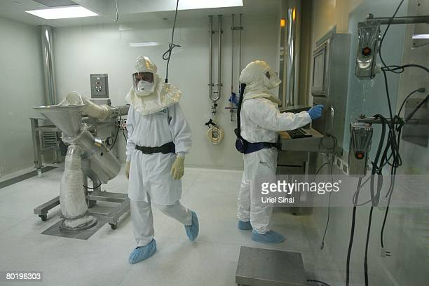 Teva Pharmaceuticals workers wear special clothing as they prepare generic drugs in a clean room at the company's manufacturing plant March 10, 2008...