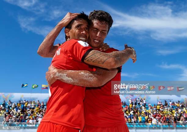 Teva Zaveroni and Naea Bennett of Tahiti celebrate their win after the FIFA Beach Soccer World Cup Bahamas 2017 semi final match between Iran and...