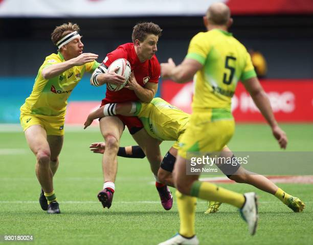 Tevaughn Campbell of Canada is tackled by Tom Connor of Australia during the Canada Sevens the Sixth round of the HSBC Sevens World Series at the BC...