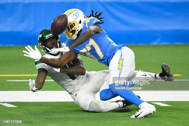 Tevaughn Campbell of the Los Angeles Chargers breaks up a catch to Denzel Mims of the New York Jets during the second half at SoFi Stadium on...