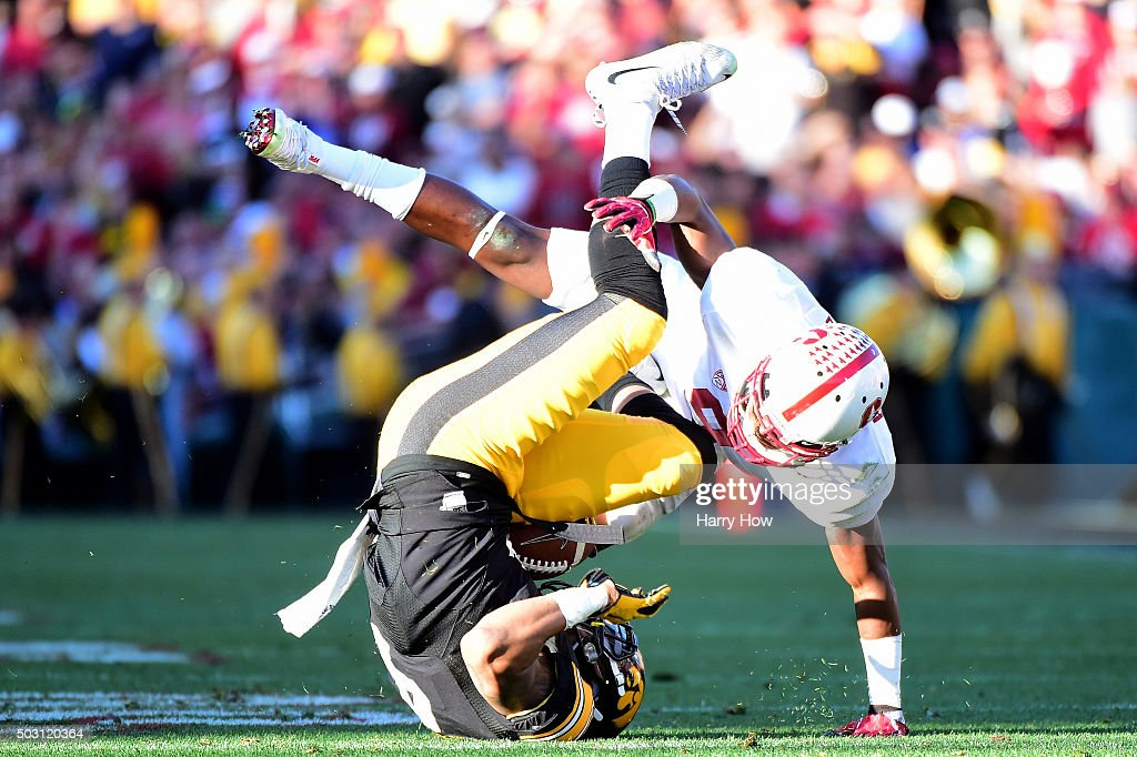 Tevaun Smith #4 of the Iowa Hawkeyes is tackled by Ben Edwards #9 of the Stanford Cardinal in the 102nd Rose Bowl Game on January 1, 2016 at the Rose Bowl in Pasadena, California.