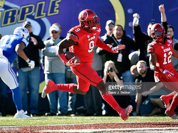 Tevin Carter of the Utah Utes runs in for a touchdown after intercepting the ball against the Brigham Young Cougars during the Royal Purple Las Vegas...