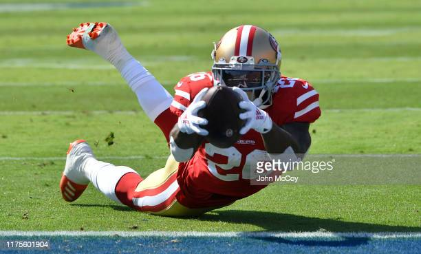 Tevin Coleman dives into the endzone to score a touchdown agtainst the Los Angeles Rams in the first quarter at Los Angeles Memorial Coliseum on...