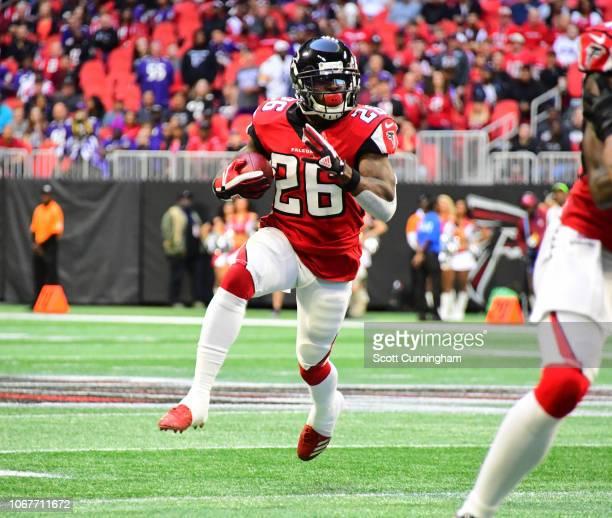 Tevin Coleman of the Atlanta Falcons carries the ball against the Baltimore Ravens at MercedesBenz Stadium on December 2 2018 in Atlanta Georgia