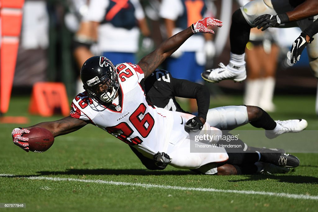 Tevin Coleman #26 of the Atlanta Falcons dives for a touchdown against the Oakland Raiders during their NFL game at Oakland-Alameda County Coliseum on September 18, 2016 in Oakland, California.