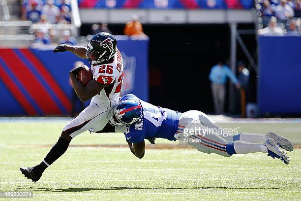 Tevin Coleman of the Atlanta Falcons is tackled by Dominique RodgersCromartie of the New York Giants in the second quarter at MetLife Stadium on...