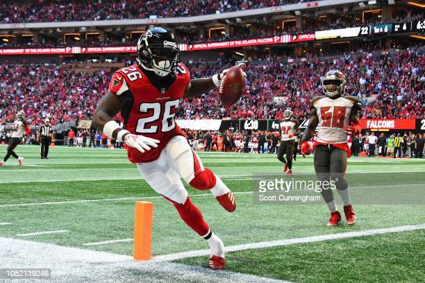 Tevin Coleman of the Atlanta Falcons makes a touchdown during the fourth quarter against the Tampa Bay Buccaneers at MercedesBenz Stadium on October...