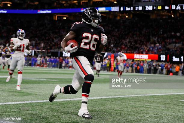 Tevin Coleman of the Atlanta Falcons runs for a touchdown during the fourth quarter against the New York Giants at MercedesBenz Stadium on October 22...