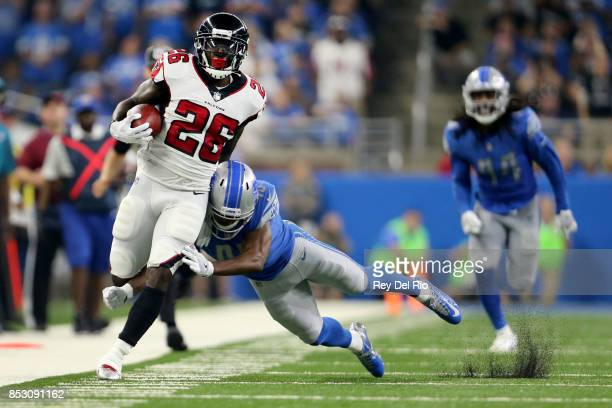 Tevin Coleman of the Atlanta Falcons runs for yardage against Charles Washington of the Detroit Lions during second quarter action at Ford Field on...