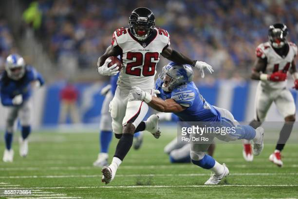 Tevin Coleman of the Atlanta Falcons runs the ball against Miles Killebrew of the Detroit Lions at Ford Field on September 024, 2017 in Detroit,...