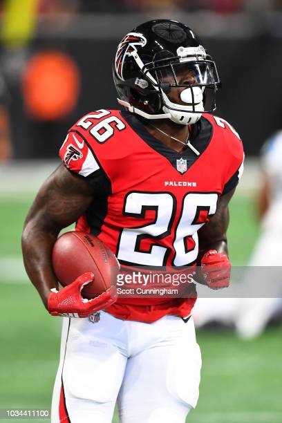 Tevin Coleman of the Atlanta Falcons runs the ball during the first half against the Carolina Panthers at MercedesBenz Stadium on September 16 2018...