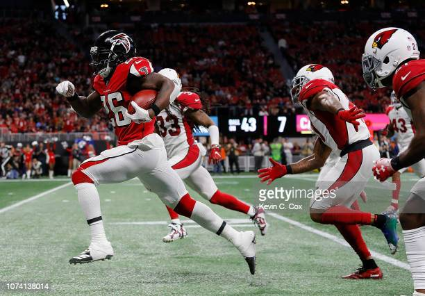 Tevin Coleman of the Atlanta Falcons rushes for a touchdown against the Arizona Cardinals at MercedesBenz Stadium on December 16 2018 in Atlanta...