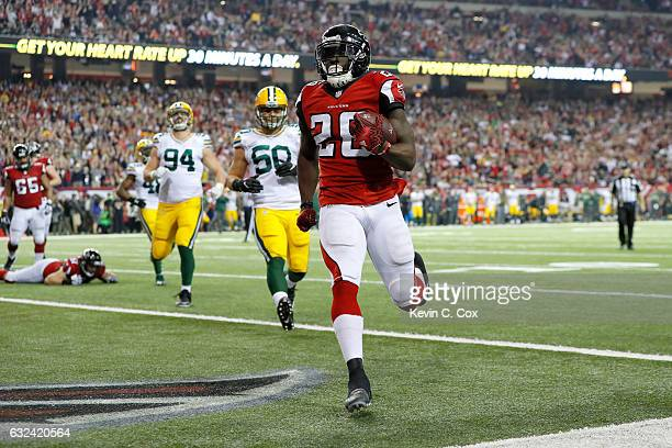Tevin Coleman of the Atlanta Falcons scores a three yard touchdown in the fourth quarter against the Green Bay Packers in the NFC Championship Game...