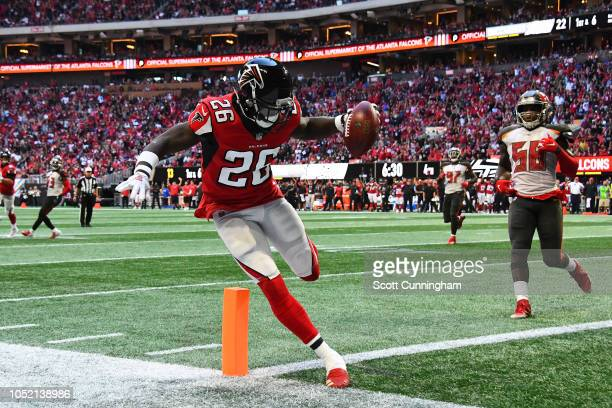 Tevin Coleman of the Atlanta Falcons scores a touchdown during the fourth quarter against the Tampa Bay Buccaneers at Mercedes-Benz Stadium on...