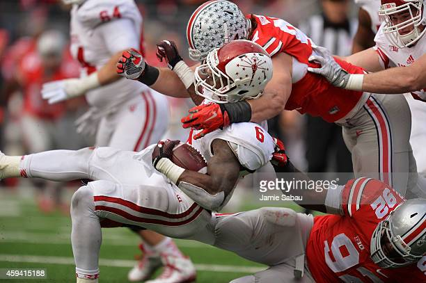 Tevin Coleman of the Indiana Hoosiers is brought down behind the line of scrimmage for a loss in the second quarter by Joey Bosa of the Ohio State...