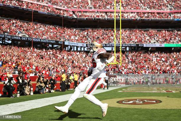 Tevin Coleman of the San Francisco 49ers celebrates after a 10-yard touchdown reception against the Carolina Panthers during the second quarter at...