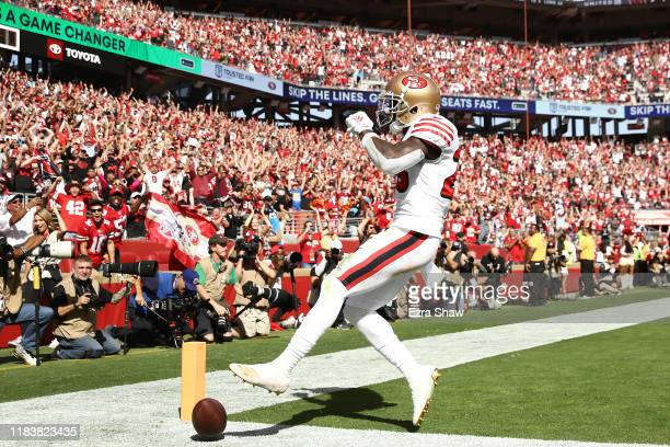 Tevin Coleman of the San Francisco 49ers celebrates after a 10yard touchdown reception against the Carolina Panthers during the second quarter at...