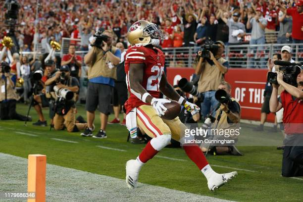 Tevin Coleman of the San Francisco 49ers celebrates after scoring a touchdown in the second quarter against the Cleveland Browns at Levi's Stadium on...