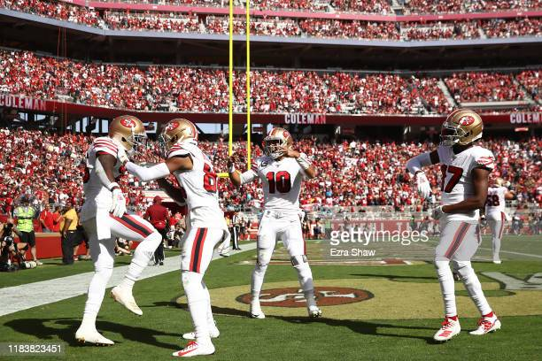 Tevin Coleman of the San Francisco 49ers celebrates with teammates after a 10yard touchdown reception against the Carolina Panthers during the second...