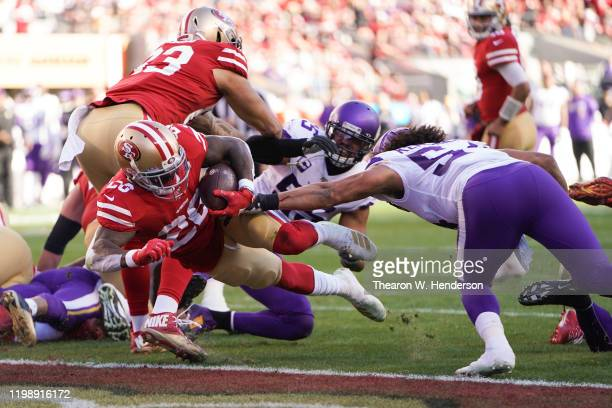 Tevin Coleman of the San Francisco 49ers dives for a touchdown against the Minnesota Vikings in the second quarter of the NFC Divisional Round...