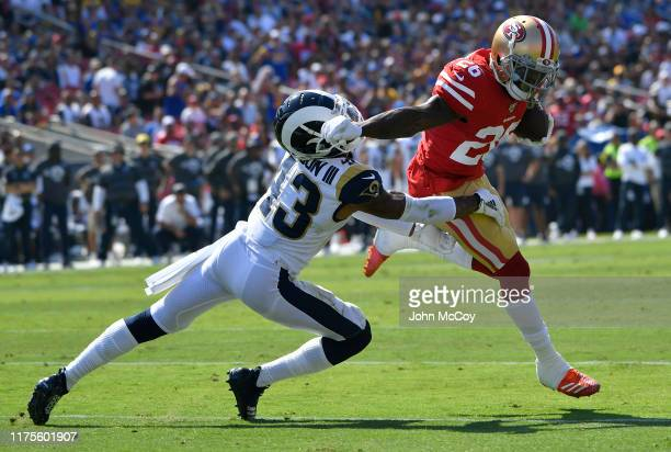 Tevin Coleman of the San Francisco 49ers gets past John Johnson of the Los Angeles Rams to score a touchdown in the first quarter at Los Angeles...