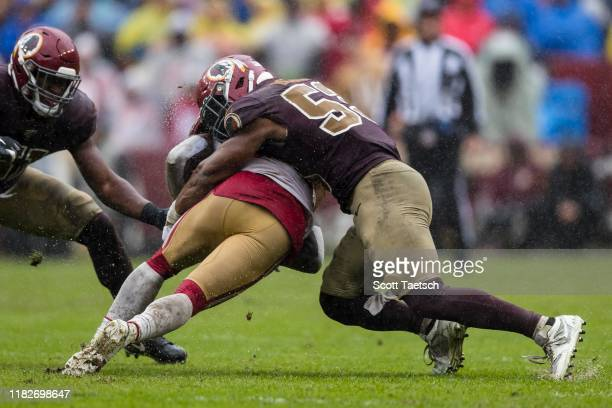 Tevin Coleman of the San Francisco 49ers is tackled by Jon Bostic of the Washington Redskins during the second half at FedExField on October 20 2019...