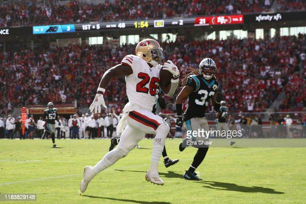 Tevin Coleman of the San Francisco 49ers runs for a 48yard touchdown against the Carolina Panthers during the second quarter at Levi's Stadium on...