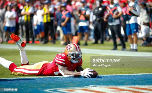 Tevin Coleman of the San Francisco 49ers rushes for a 2yard touchdown during the game against the Los Angeles Rams at the Los Angeles Memorial...