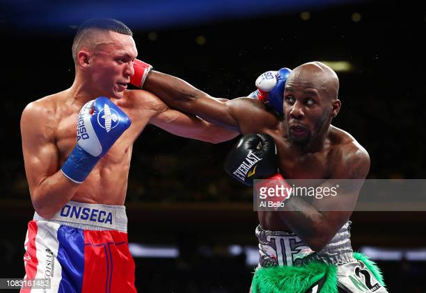 Tevin Farmer and Francisco Fonseca exchange punches during their IBF junior lightweight title fight at Madison Square Garden on December 15, 2018 in...