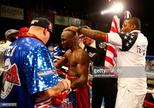 Tevin Farmer celebrates with his team following the junior lightweight win against Emmanuel Gonzalez at the House of Blues on June 5, 2014 in Boston,...