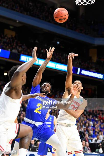 Tevin King of the South Dakota State University has his shot blocked by Keita BatesDiop of the Ohio State University during the First Round of the...