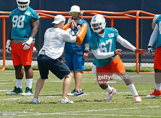 Tevin Mims of the Miami Dolphins participates in drills during the rookie minicamp on May 23 2014 at the Miami Dolphins training facility in Davie...