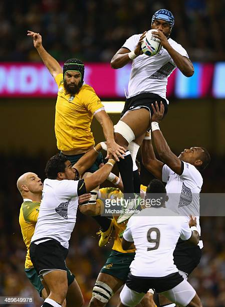 Tevita Cavubati of Fiji jumps ahead of Scott Fardy of Australia at the line out during the 2015 Rugby World Cup Pool A match between Australia and...