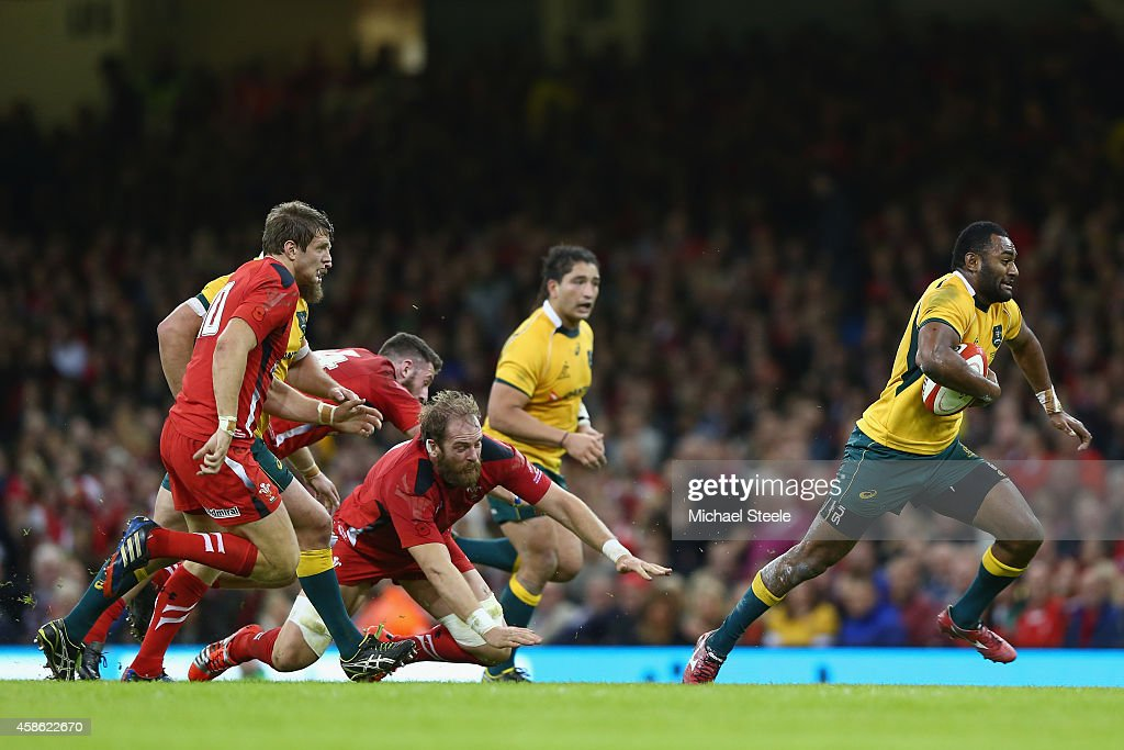 Tevita Kuidrani (R) of Australia breaks through the challenge of Alun Wyn Jones of Wales to score his sides third try during the International match between Wales and Australia at the Millennium Stadium on November 8, 2014 in Cardiff, Wales.