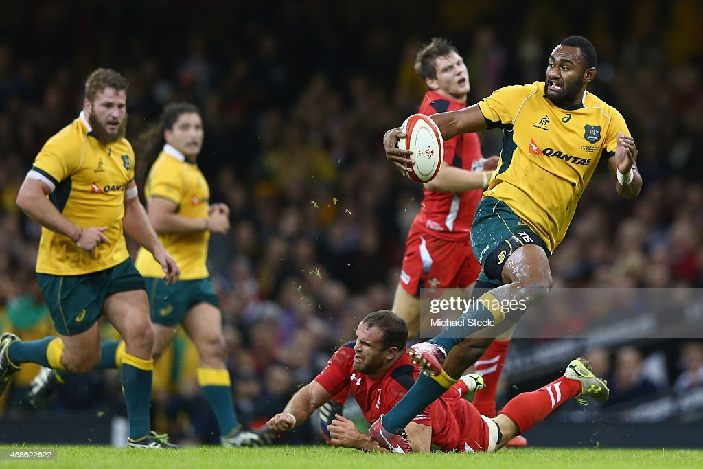Tevita Kuidrani (R) of Australia breaks through the challenge of Jamie Roberts of Wales to score his sides third try during the International match between Wales and Australia at the Millennium Stadium on November 8, 2014 in Cardiff, Wales.