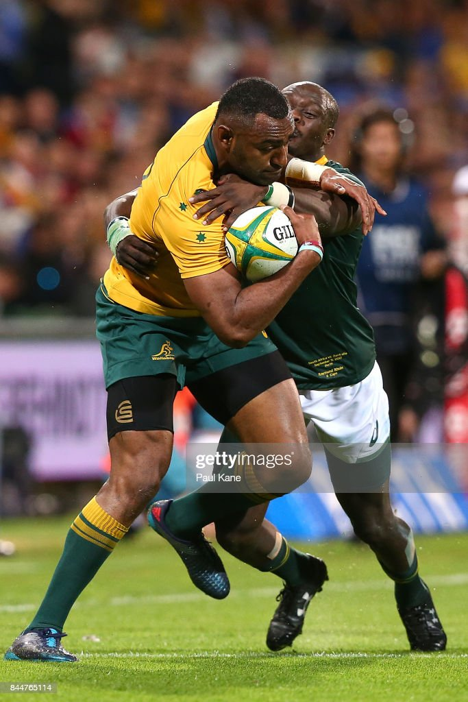 Tevita Kuridrani of Australia attempts to break from a tackle by Raymond Rhule of South Africa during The Rugby Championship match between the Australian Wallabies and the South Africa Springboks at nib Stadium on September 9, 2017 in Perth, Australia.