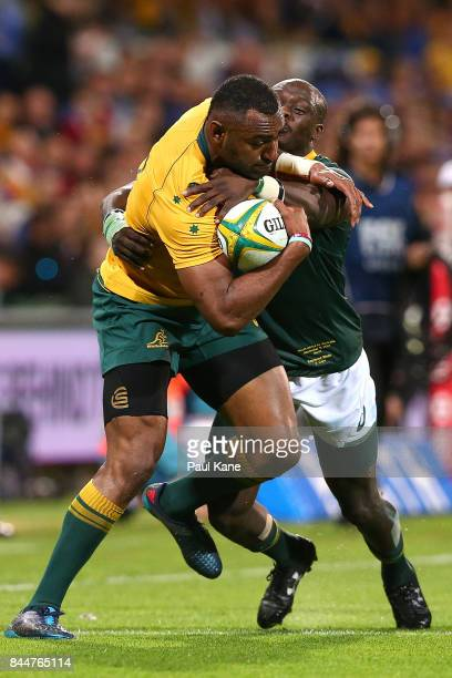 Tevita Kuridrani of Australia attempts to break from a tackle by Raymond Rhule of South Africa during The Rugby Championship match between the...