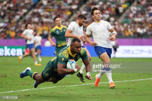 Tevita Kuridrani of Australia dives to score his side's fourth try during the Rugby World Cup 2019 Group D game between Australia and Uruguay at Oita...
