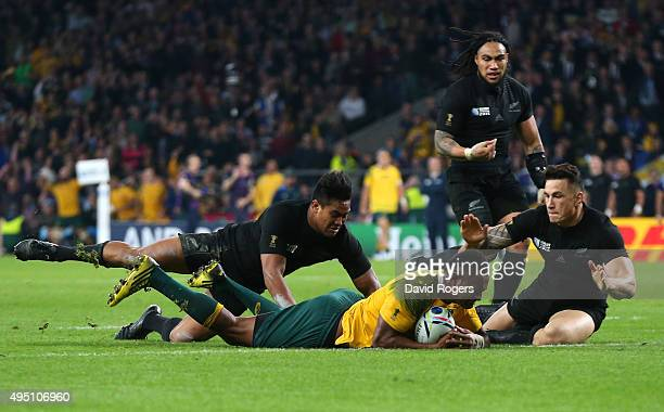 Tevita Kuridrani of Australia scores his team's second try despte the efforts of Julian Savea of New Zealand during the 2015 Rugby World Cup Final...