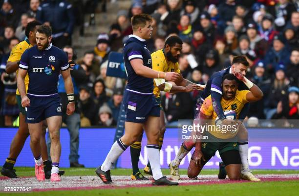 Tevita Kuridrani of Australia touches down for the first try during the international match between Scotland and Australia at Murrayfield Stadium on...